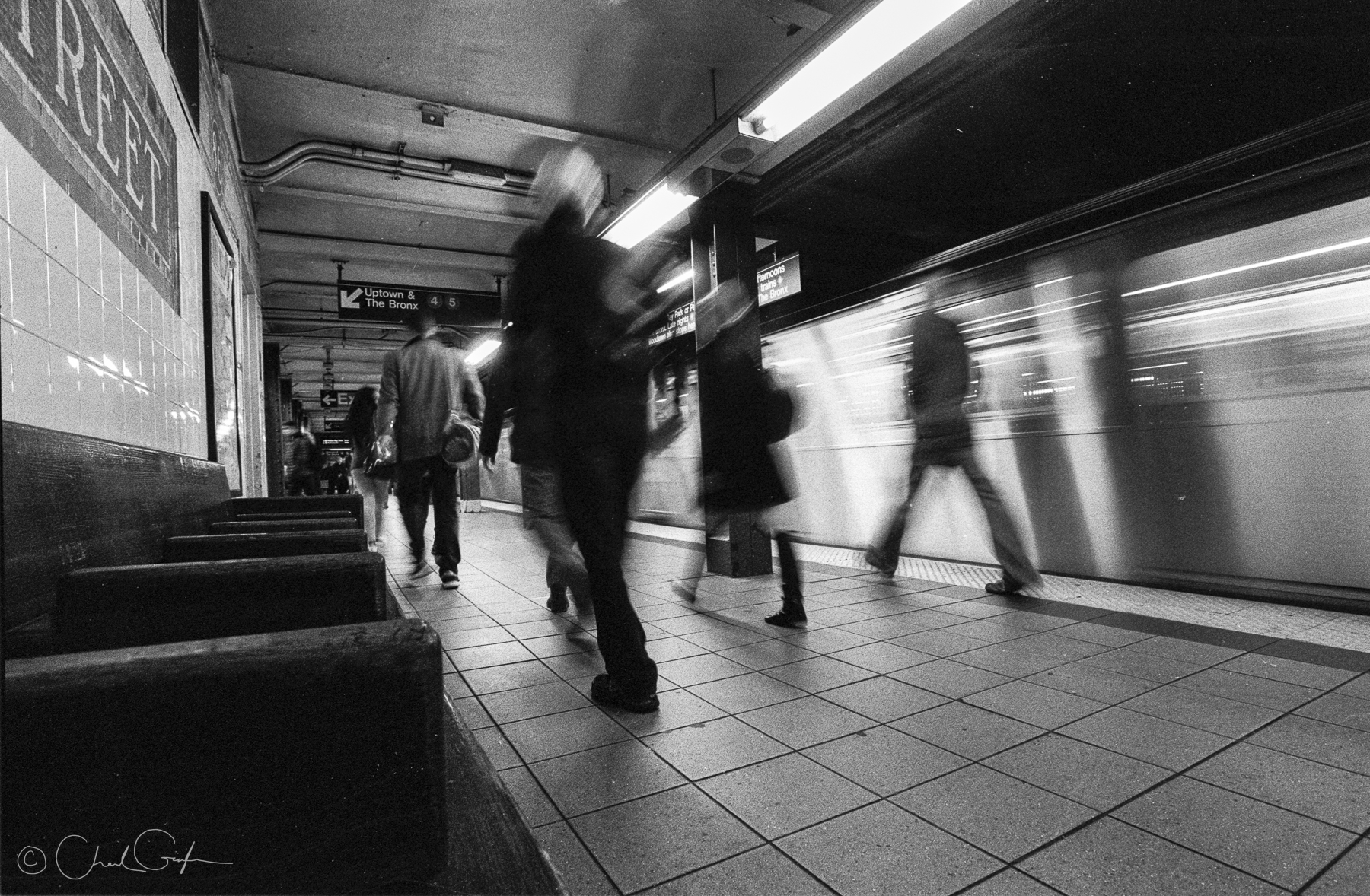 Figures in a Train Station (Image by Chad Gayle)