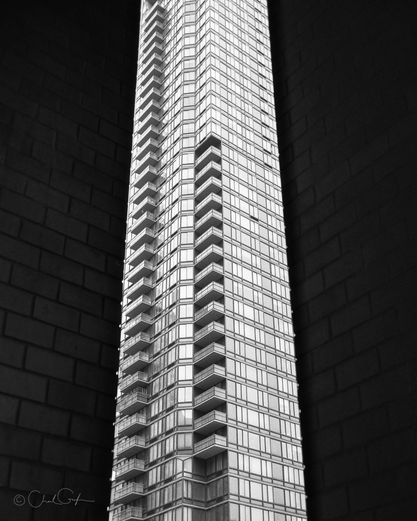 Skyscraper Squeezed Between Brick Pillars by Chad Gayle (Image)