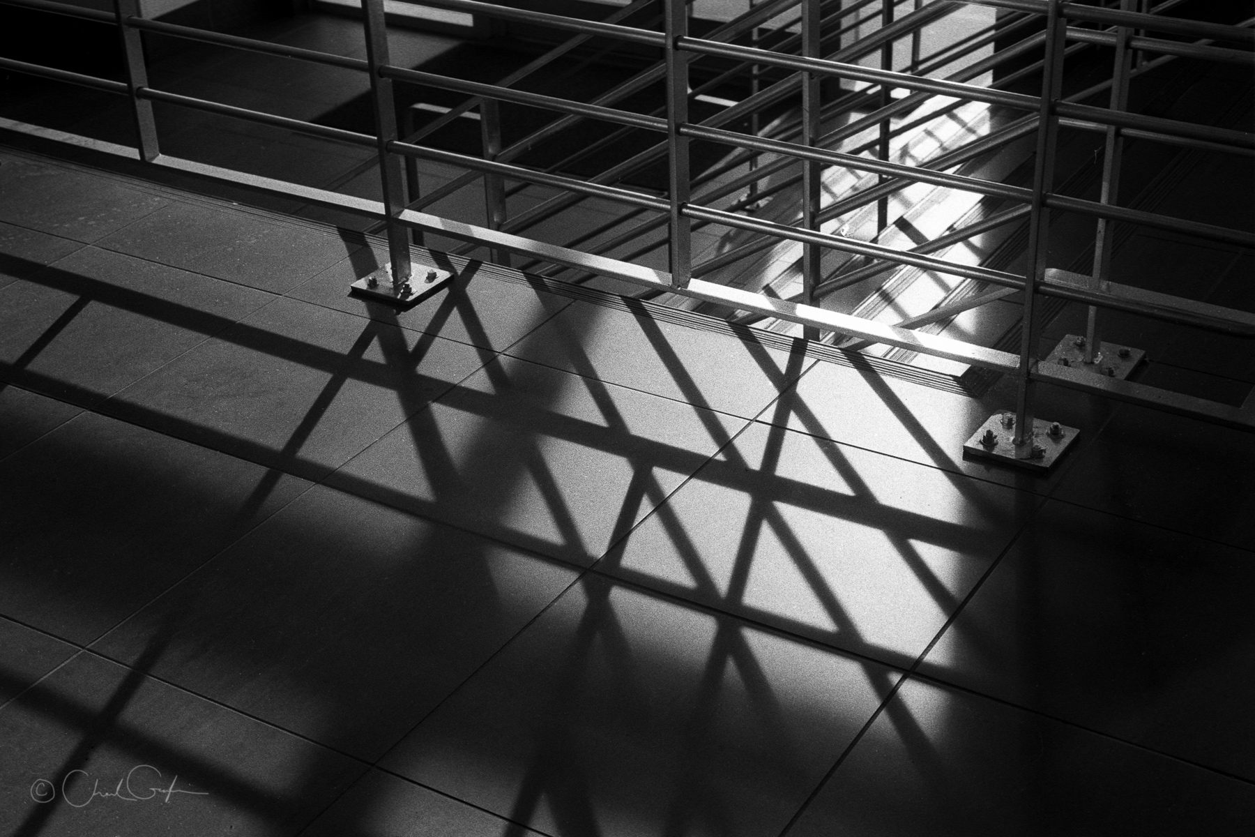 Sunlight casting shadows on station stairs by chad gayle image